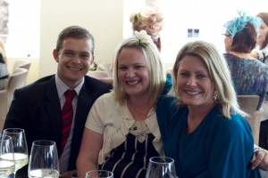 Garreth, Sarah and Anna enjoy the Raffles
