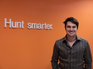 Chris M. in front of our 'Hunt Smarter' sign