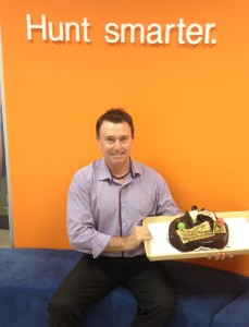Chris Batini plus cake to celebrate his 20 years in market research.